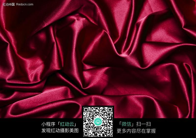 褶皱的暗红色绸缎背景素材