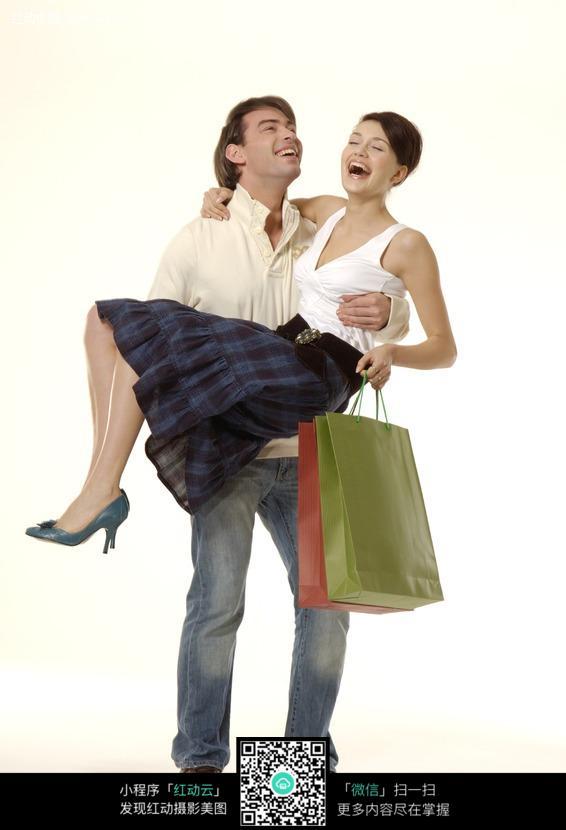 抱起购物的美女图片编号:292746