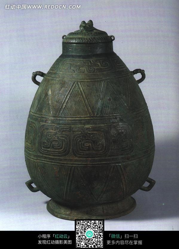 椭圆形古代青铜壶设计图片