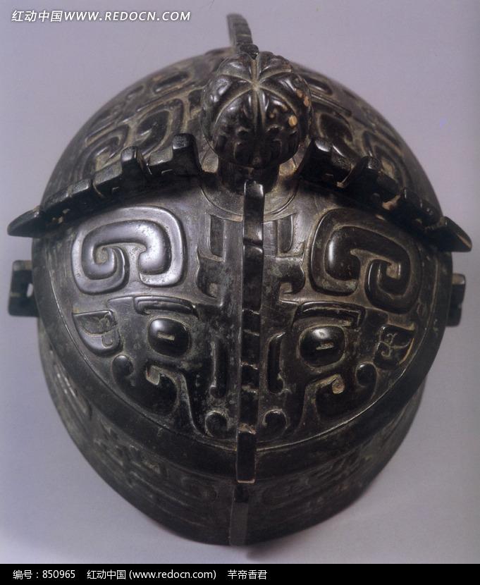 青铜卣顶部图案特写设计图片